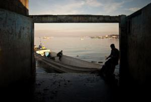 A Filipino fisherman rests at one of the fish markets near Manila. Ezra Acayan/Demotix. All rights reserved
